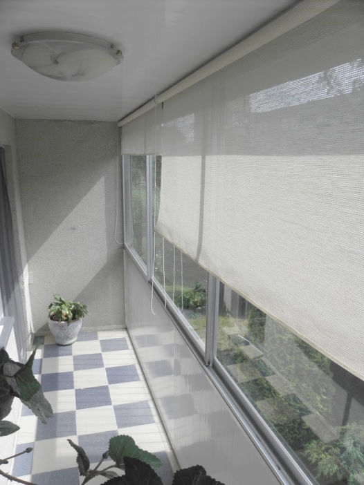 Zabudowa balkonu wraz z roletami